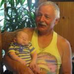 Visiting with Grandpa Kramer...OK make that sleeping on Grandpa Kramer (July 17th)