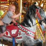 Riding the Badger pony on the Ella's Deli carousel in Madison - June 17th 2012