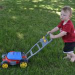 Mowing the lawn with Daddy - July 4th